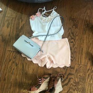 Scalloped pastel pink shorts
